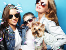 Two sisters and brother with yorkshire terrier Royalty Free Stock Photos