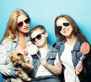 Two sisters and brother with yorkshire terrier Stock Images