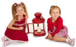 Two sisters about candles Stock Images