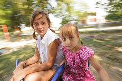 Two sisters on the carousel Royalty Free Stock Image