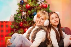 Two sisters celebrating Christmas Royalty Free Stock Photos