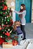 Two sisters child decorate the Christmas tree. The concept of Ch Royalty Free Stock Images