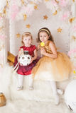 Two sisters with Christmas presents Royalty Free Stock Images