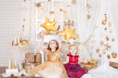 Two sisters with Christmas presents Royalty Free Stock Photo
