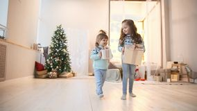 Two sisters in the Christmas run to give gifts to their parents. Two sisters in the Christmas run to give gifts to their parents stock video