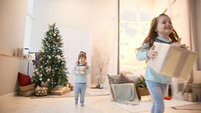 Two sisters in the Christmas run to give gifts to their parents. Two sisters in the Christmas run to give gifts to their parents stock video footage