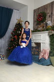 Two sisters at the Christmas tree royalty free stock photo