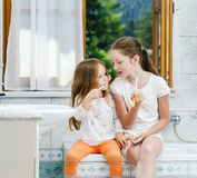 Two sisters cleaning the teeth together Stock Images