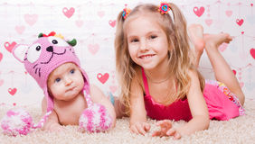 Two sisters with different mood Stock Image