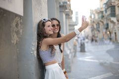 Two sisters doing a selfie Stock Photos