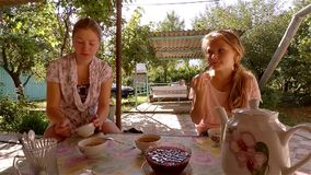 Two sisters eat jam in crimean tataric house in sunny afternnon. Two sisters eat jam in crimean tataric house in sunny warm summer afternnon stock video