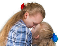 Two sisters embracing and kissing Royalty Free Stock Image