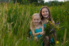 Two sisters at the evening field Royalty Free Stock Photography