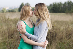 Two sisters or female friends in a close embrace Stock Images