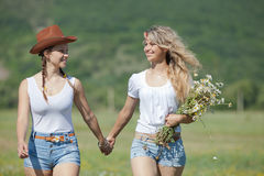 Two sisters in field Royalty Free Stock Images