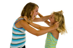 Two sisters fighting royalty free stock photo