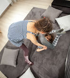 Two sisters fighting on couch Stock Images