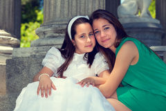 Two sisters in the First Communion Day Royalty Free Stock Photography