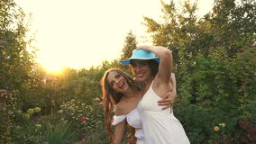 Two sisters are fooled with hats stock footage