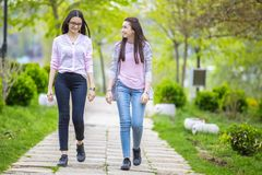 Two sisters friends having fun in the park Royalty Free Stock Photo