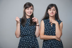 Two sisters with funny faces Stock Image