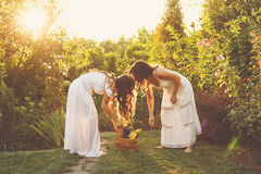 Two sisters gather the harvest Stock Photo