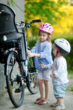 Two sisters going to have a bicycle ride Royalty Free Stock Photos