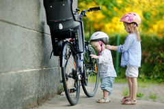 Two sisters going to have a bicycle ride Stock Image