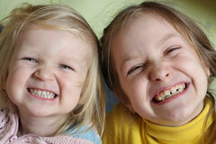 Two sisters grimaces Royalty Free Stock Images