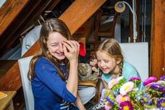 Two sisters are happy together,speaking and smiling royalty free stock images