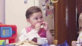 Two sisters having breakfast at the table. stock footage