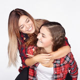 Two sisters having fun and laughing. Royalty Free Stock Photo