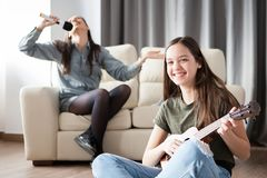 Two sisters having fun in the living room Stock Photography