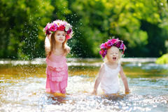Two sisters having fun by a river Stock Photos
