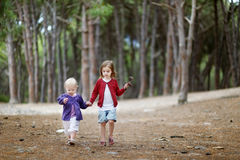 Two sisters having a walk in the woods Stock Photos