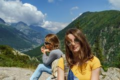 Two sisters in high Alps, France, sunny day stock images