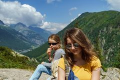 Two sisters in high Alps, France, sunny day royalty free stock images