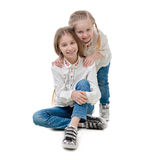 Two sisters holding each other, isolated Royalty Free Stock Image