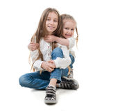 Two sisters holding each other, isolated Stock Image