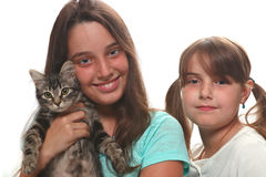 Two Sisters Holding Their Young Kitten Royalty Free Stock Photography