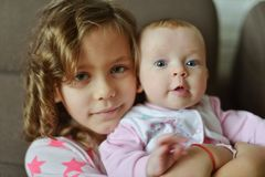 Two sisters at home Royalty Free Stock Photo