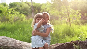 Two sisters hug. Family time stock footage