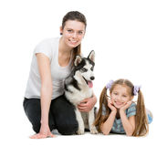 Two sisters and a husky dog Stock Images