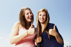 Two sisters interacting making peace sign Stock Images