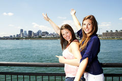 Two Sisters Interacting With City Behind Royalty Free Stock Images