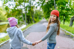 Two sisters joined hands Stock Photos