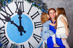 Two sisters kiss her mother. Christmas Eve. Stock Photography
