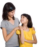 Two sisters looking at each other Stock Photography