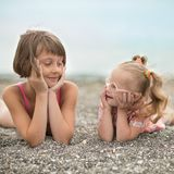 Two sisters looking at each  other with love. Two sisters looking at each other with love Stock Images