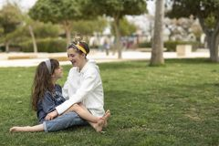 Two sisters looking at each other smiling. royalty free stock photo